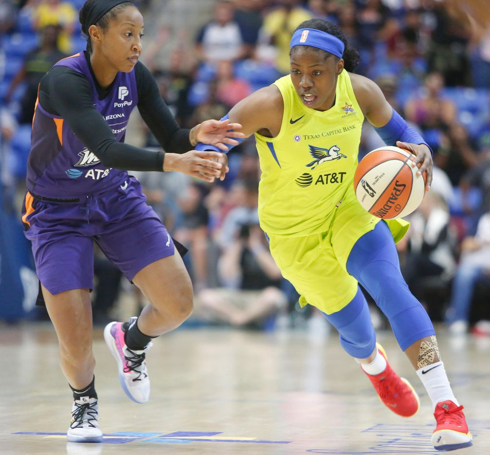 Dallas Wings guard Arike Ogunbowale (24) drives to the basket past the defense of Briann January (12) during 4th quarter action. The Wings defeated the Mercury, 69-54. The two teams played their WNBA game at UT-Arlington's College Park Center in Arlington on June, 20, 2019.  (Steve Hamm/ Special Contributor)