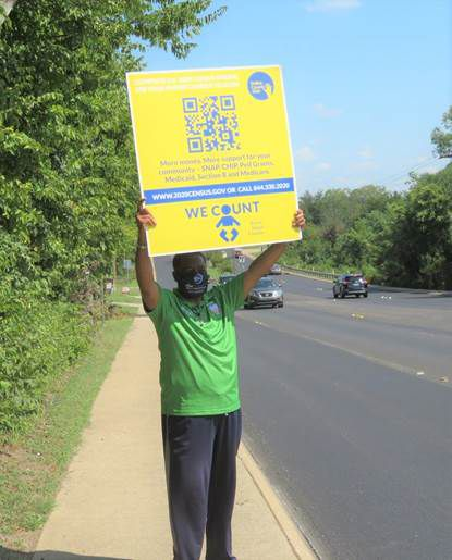 DeSoto councilman and Pastor Andre Byrd is seen holding a sign promoting and encouraging citizens to fill out the 2020 U.S. Census.