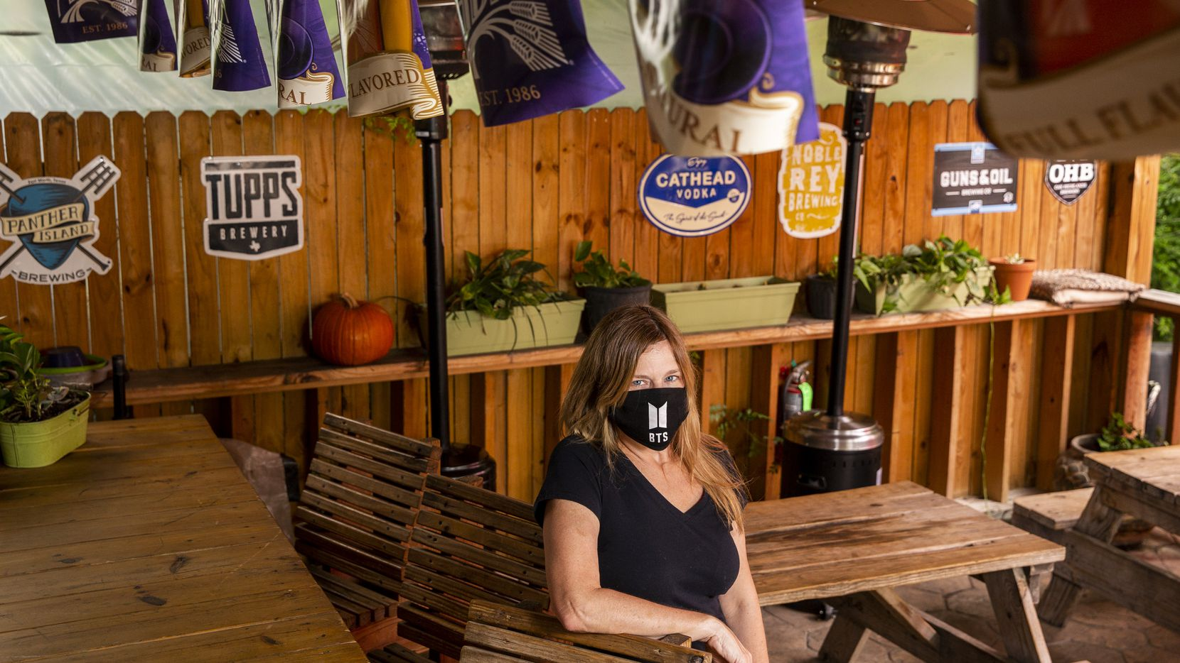 Owner Meri Dahlke poses for a portrait at Ten Bells Tavern in the Bishop Arts District of Dallas on Thursday, May 21, 2020. Texas Governor Greg Abbott announced on Monday that bars may begin reopening at 25% capacity on Friday.  (Lynda M. Gonzalez/The Dallas Morning News Pool)