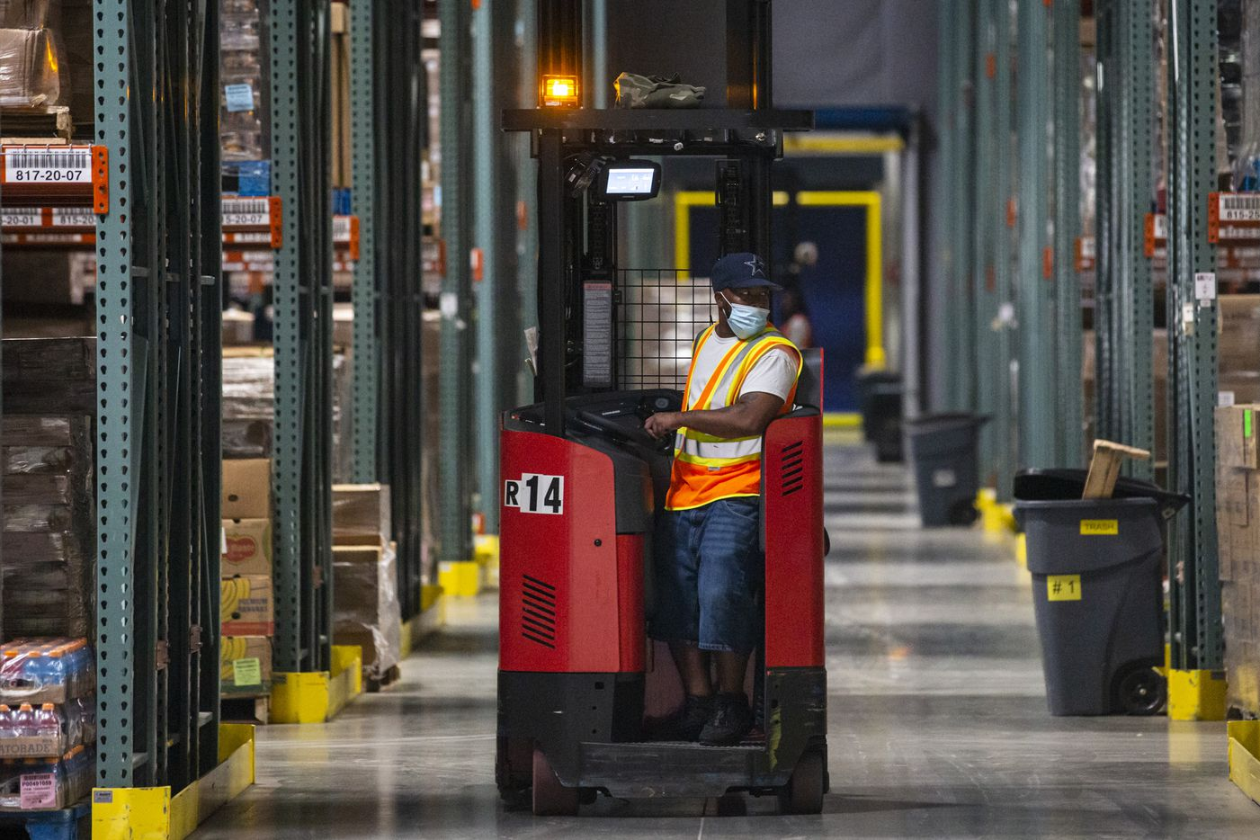 A receiver associate operates equipment to help unload and sort food inventory at the North Texas Food Bank Perot Family Campus in Plano on  June 15.