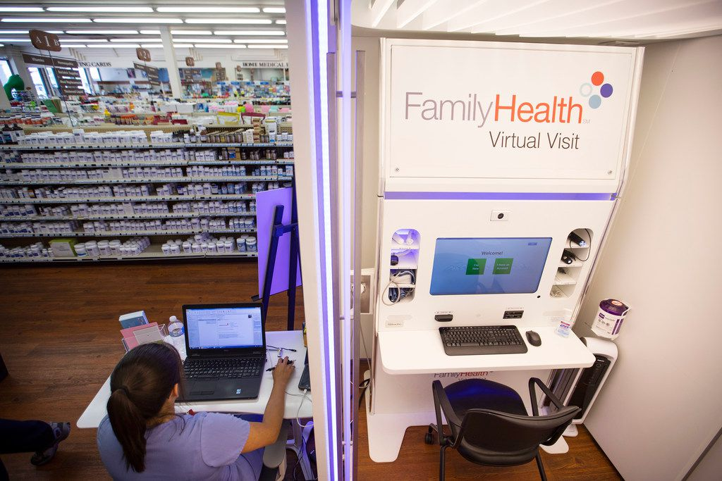Children's Health virtual health project coordinator Vanessa Hawkins works beside the Family Health Virtual Visit kiosk in the flagship Dougherty's Pharmacy in Preston Royal Village.