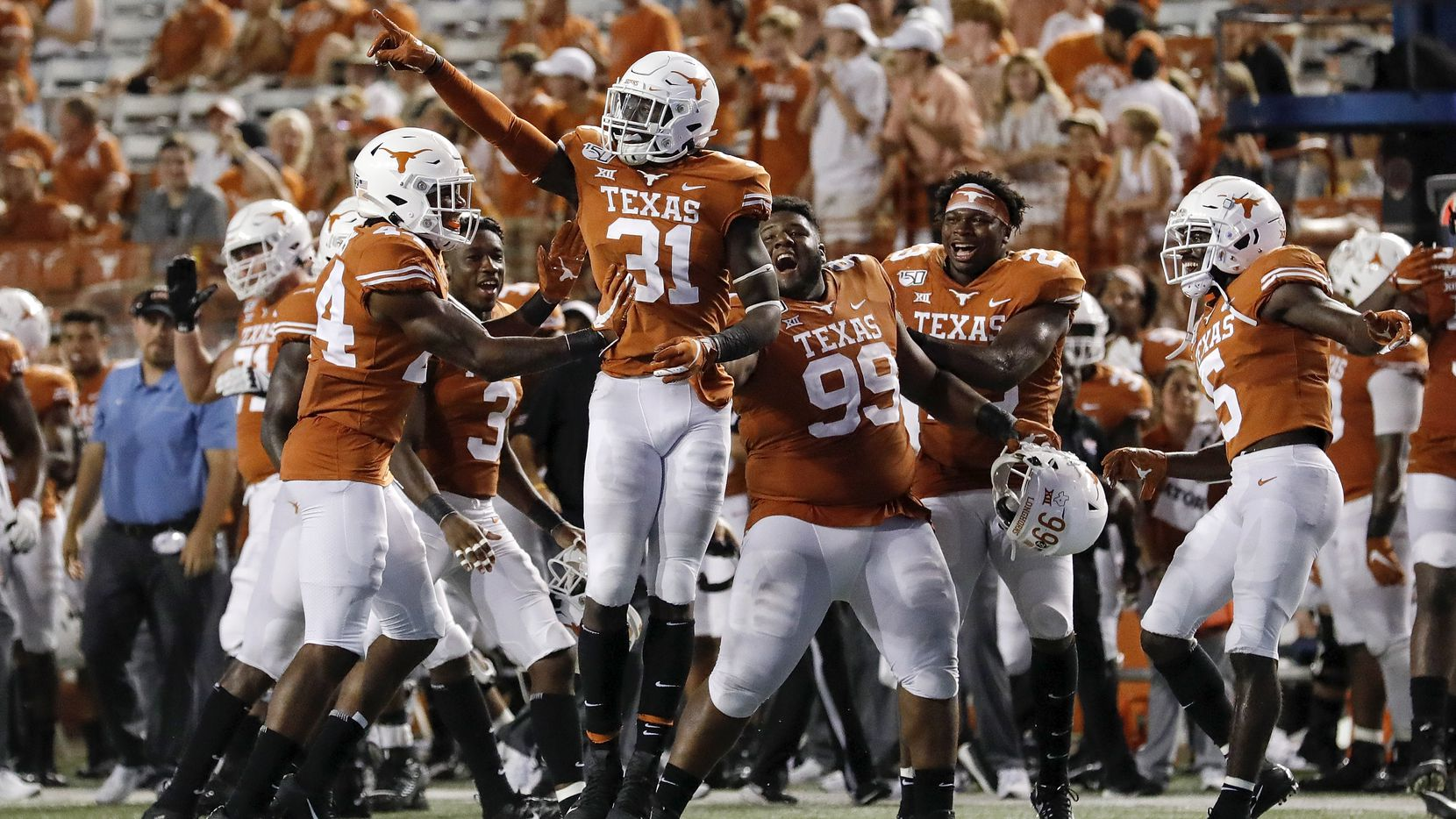 FILE - DeMarvion Overshown (31) of Texas celebrates with teammates after an interception in the fourth quarter against Louisiana Tech at Darrell K Royal-Texas Memorial Stadium on Aug. 31, 2019 in Austin.