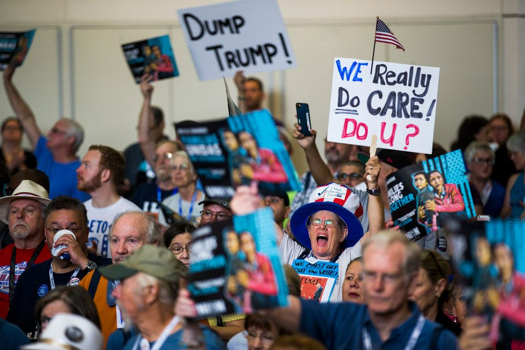 Irene Andrews shouts and holds a sign during a Families First Rally at the Texas Democratic Convention on Saturday, June 23, 2018 at the Fort Worth Convention Center in Fort Worth.