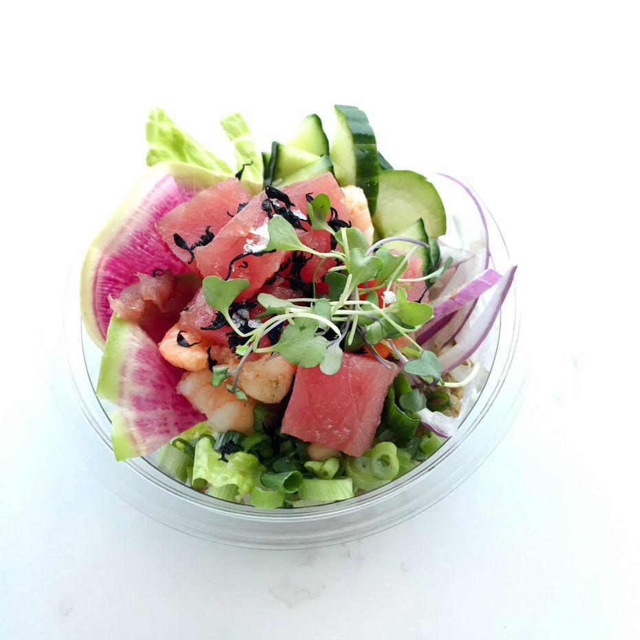 "Freshfin Poke Co.'s signature Hawaiian OG poke bowl with one tweak: half ahi tuna and half shrimp, instead of all ahi. Plus: green and red onion; watermelon radish; hijiki seaweed; Maldon salt and ""umami shoyu"" sauce."