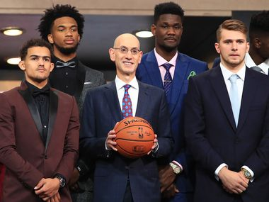 NEW YORK, NY - JUNE 21: NBA Commissioner Adam Silver (C) poses with NBA Draft Prospects Trae Young, Marvin Bagley III, Deandre Ayton and Luka Doncic before the 2018 NBA Draft at the Barclays Center on June 21, 2018 in the Brooklyn borough of New York City.
