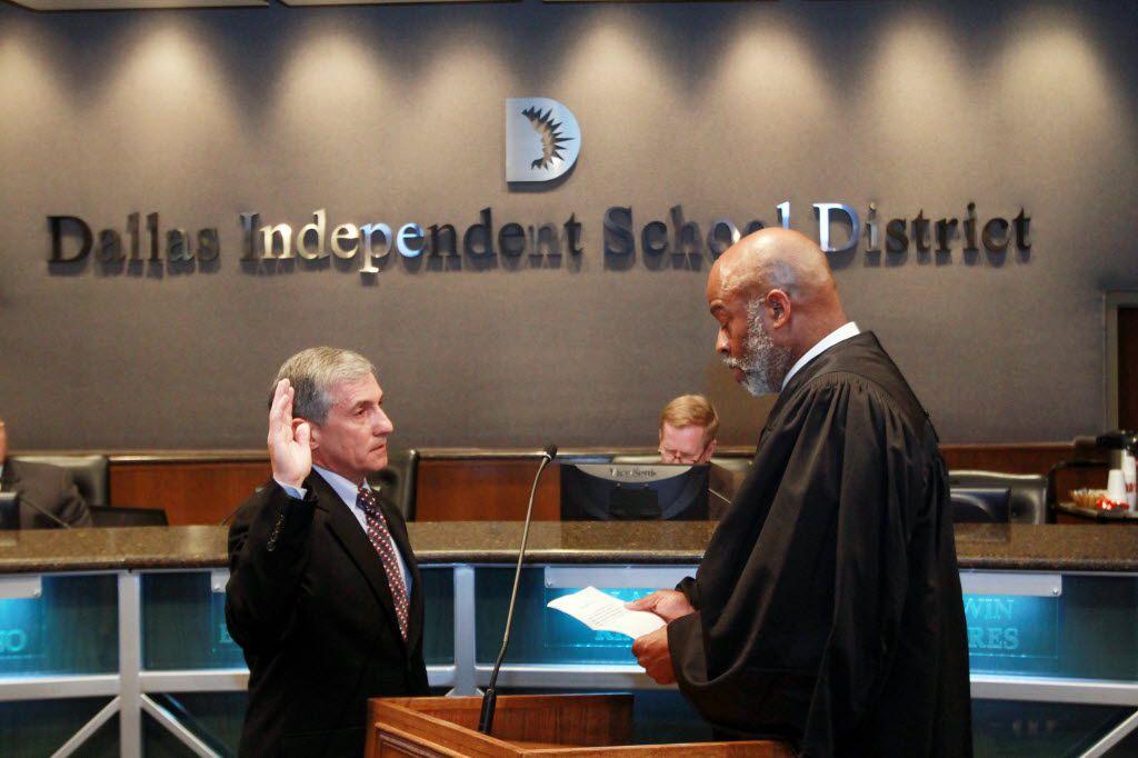 Judge Eric Moyé, right, swears in new Dallas school board trustee Dan Micciche on May 24, 2012, at DISD headquarters.