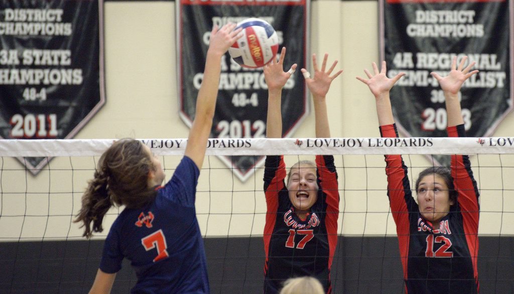 Lovejoy's Rosemary Archer (17) and Hannah Gonzalez (12) go up for the block on McKinney North's Sydney Huck during a high school volleyball match between McKinney North and Lovejoy, Thursday, Oct. 29, 2019 in Lucas, Tex. Lovejoy won in straight sets. (Photo by Matt Strasen/Special Contributor)