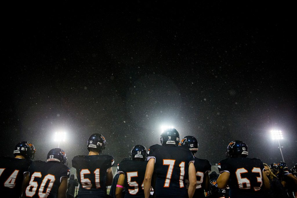 Sachse players stand on the sideline in the rain during the fourth quarter of a District 10-6A high school football game between Sachse and Garland Lakeview on Thursday, October 24, 2019 at Williams Stadium in Garland. (Ashley Landis/The Dallas Morning News)