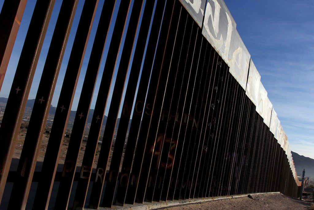 A border fends stands between Mexico and the United States in the El Paso area. About 700 miles of fencing is already in place along the 2,000-mile border.
