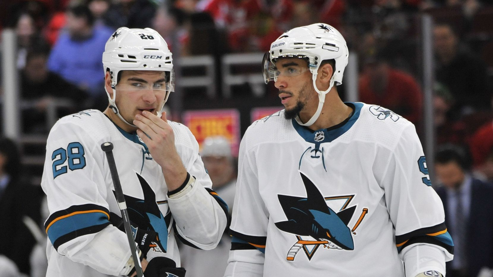 San Jose Sharks' Timo Meier (28) talks with teammate Evander Kane (9) during the third period of an NHL hockey game against the Chicago Blackhawks Wednesday, March 11, 2020, in Chicago.