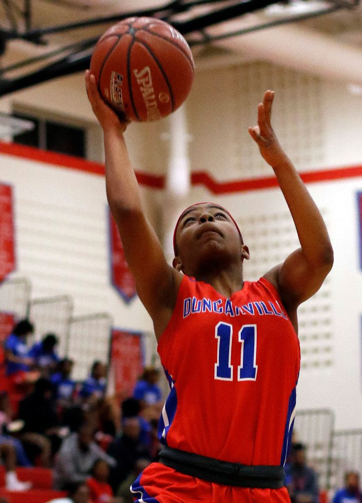 Duncanville's Tristen Taylor (11) scores on a fast break during first half action against Dallas Skyline. The two teams played their girls basketball game at  Skyline High School in Dallas on January 7, 2020. (Steve Hamm/ Special Contributor)