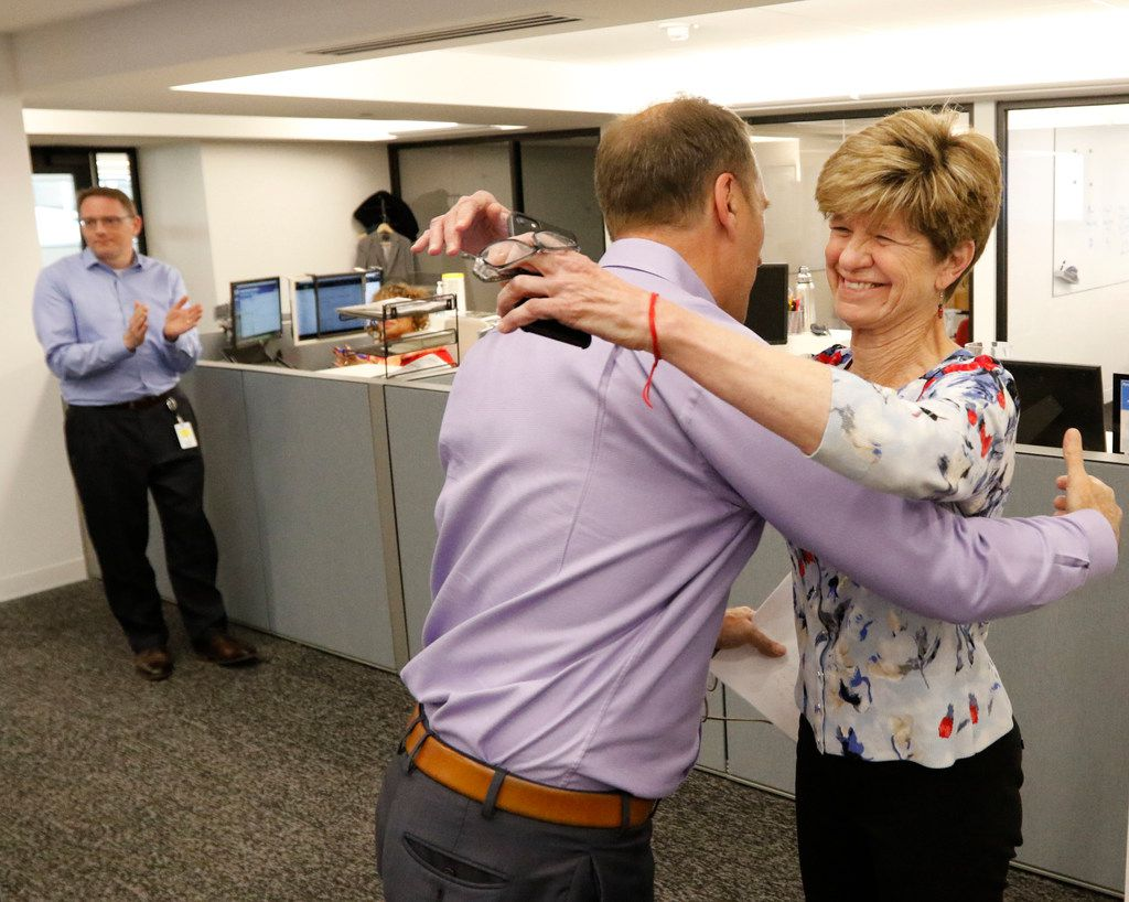 Dallas Morning News editor Mike Wilson hugs 2018 Pulitzer Prize editorial writing finalist Sharon Grigsby during an announcement in The Dallas Morning News newsroom on Monday, April 16, 2018.
