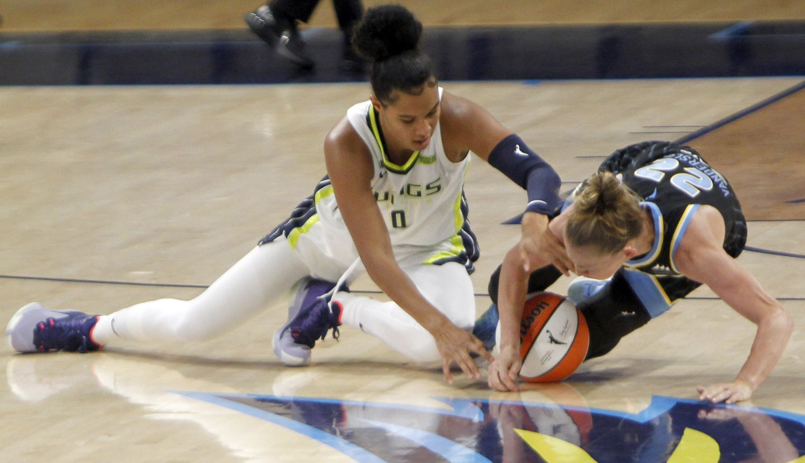 Dallas Wings forward Satou Sabally (0), left, battles Chicago Sky guard Courtney Vandersloot (22) for a loose ball during first half action. The two WNBA teams played their game at College Park Center in Arlington on July 2, 2021. (Steve Hamm/ Special Contributor)