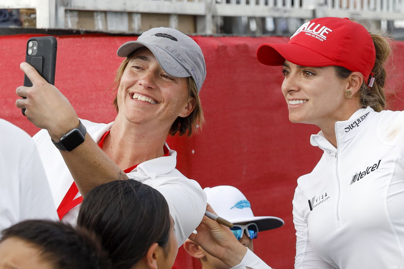 Professional golfer Gaby Lopez poses for a selfie with a fan after completing the final round of the LPGA VOA Classic on Sunday, July 4, 2021, in The Colony, Texas. Lopez placed third in the tournament at 14 under par. (Elias Valverde II/The Dallas Morning News)