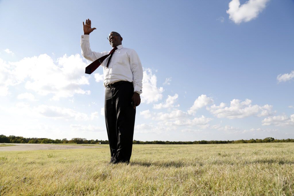 Dallas City Council member Tennell Atkins talks as he stands by the Dallas executive airport runway as he gives the Dallas Morning News reporter and photographer a tour around the airport in Dallas, TX on October 3, 2013. (Kye R. Lee/The Dallas Morning News)
