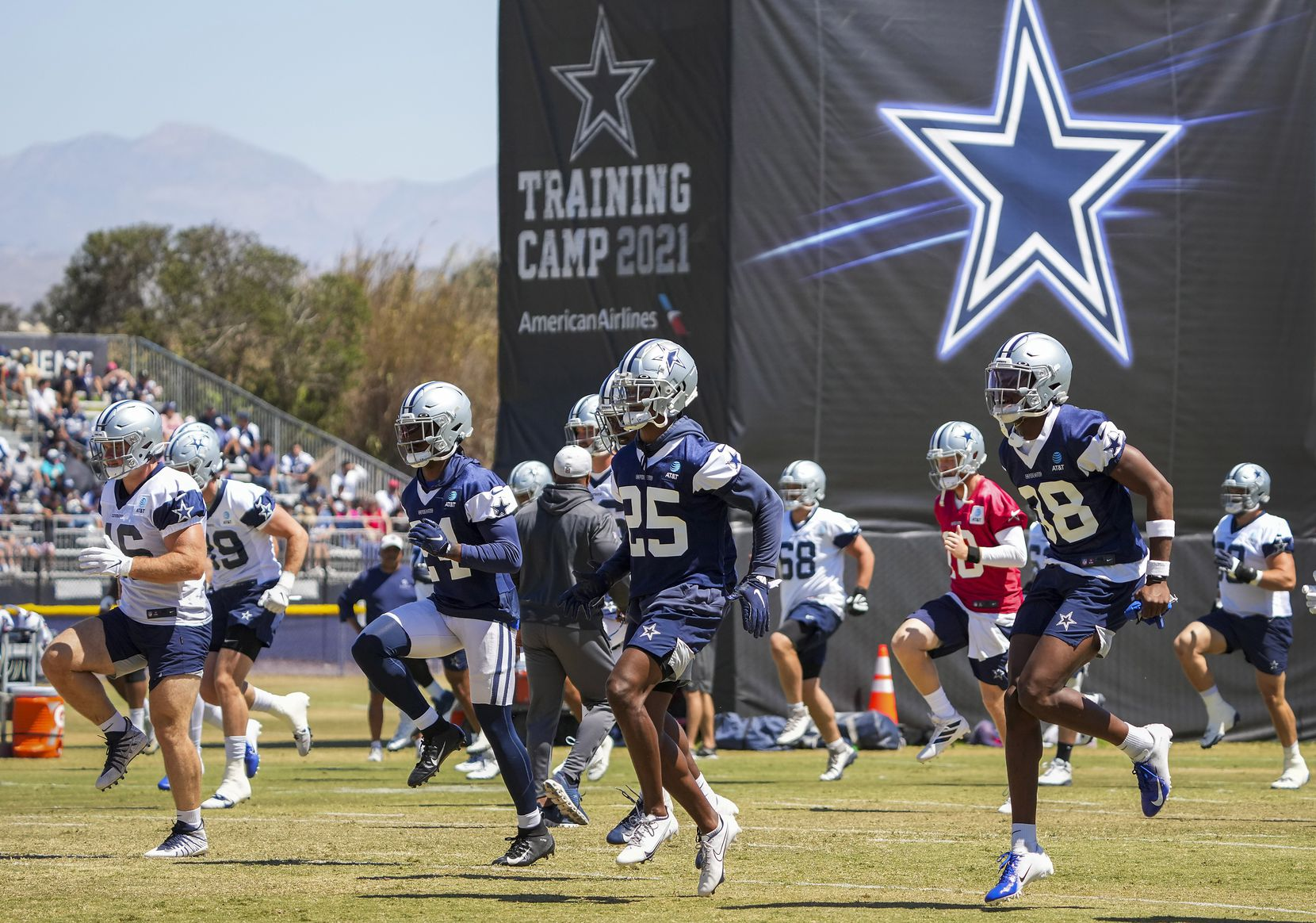 Dallas Cowboys players, including cornerback Israel Mukuamu (38), safety Steven Parker (25) and cornerback Kelvin Joseph (24) stretch during a practice at training camp on Tuesday, Aug. 3, 2021, in Oxnard, Calif.