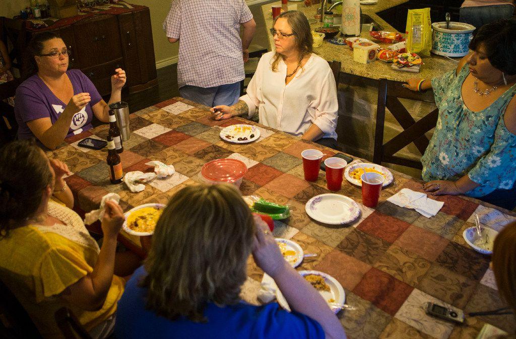 Melissa Ballard (left) talks as Mela Singleton (center) and Melissa Baize listen on July 7, 2017, in Little Elm.