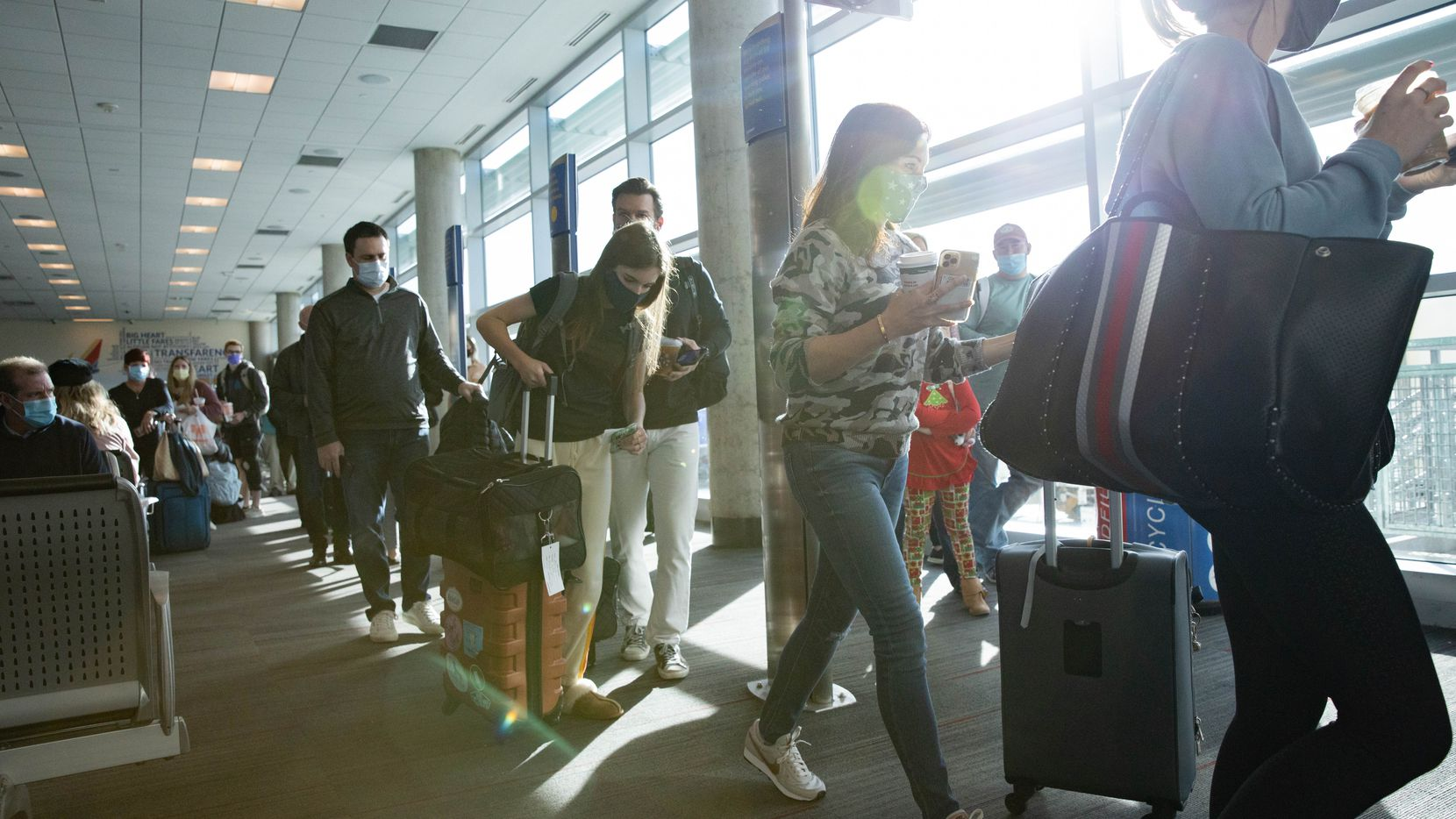 Holiday travelers board their Southwest flight at Dallas Love Field Airport in Dallas on Wednesday, Dec. 23, 2020. (Juan Figueroa/ The Dallas Morning News)