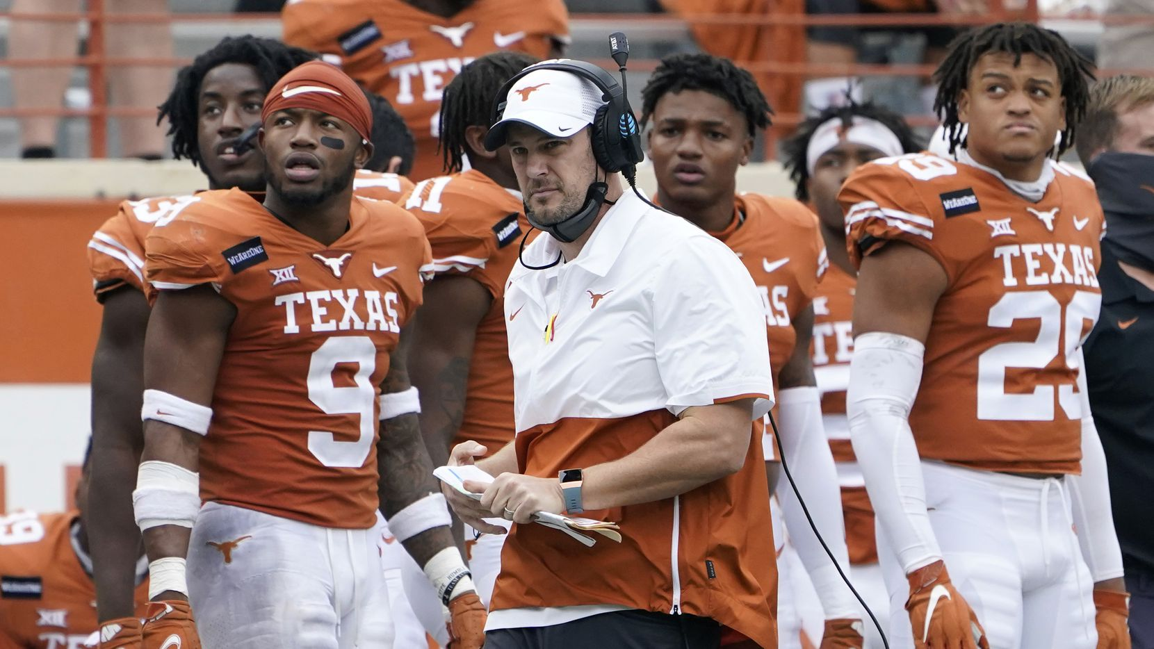 Texas head coach Tom Herman, center, on the side lines during the second half of an NCAA college football game against Iowa State, Friday, Nov. 27, 2020, in Austin, Texas.