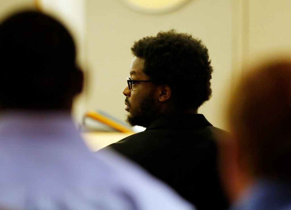Thomas Johnson watches as jurors make their way out of the courtroom during the second day of his murder trial at Frank Crowley Courts Building in Dallas on Tuesday.