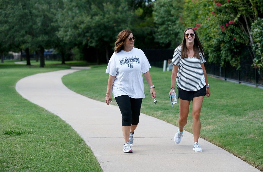 Amy Hardesty walks with Annika Rains near Fisher Elementary School in Frisco on Aug. 29. Hardesty and Rains both taught at Truman Primary School in Norman, Okla., last year. Rains has moved to Little Elm to teach at Vaughn Elementary School in Frisco. Hardesty commutes from Norman on the weekends.