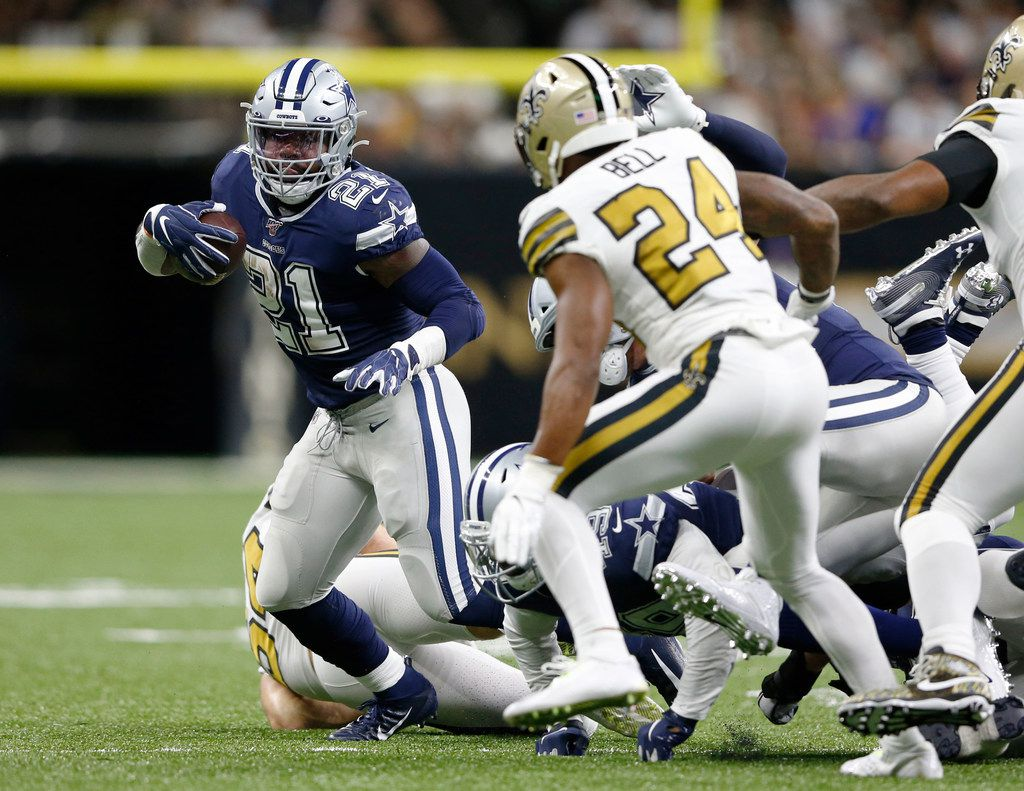 Dallas Cowboys running back Ezekiel Elliott (21) runs up the field as New Orleans Saints strong safety Vonn Bell (24) prepares to tackle him during the first half of play at the Superdome in New Orleans, Louisiana on Sunday, September 29, 2019.