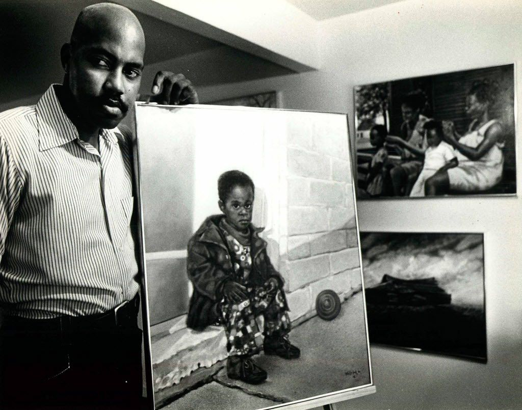Dallas artist Arthello Beck Jr. posed with a portrait of his son in July 1979.