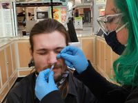 Piercer Mishawn Zengota in Tacoma Mall in Washington with Piercing Pagoda customer James Berube.
