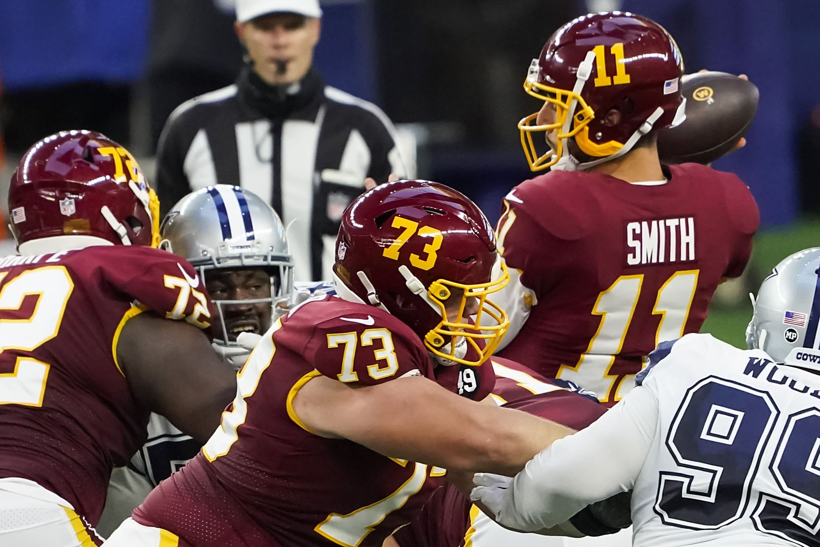 Washington Football Team quarterback Alex Smith (11) is sacked by Dallas Cowboys defensive end Randy Gregory during the second quarter of an NFL football game at AT&T Stadium on Thursday, Nov. 26, 2020, in Arlington. (Smiley N. Pool/The Dallas Morning News)