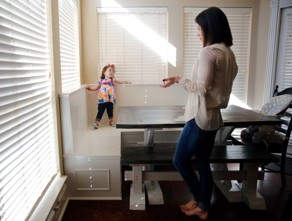 Natalie Gregory (right) needs 24-hour medical care for her 2 year-old daughter Christina who suffers from CCHS (Congenital Central Hypoventilation Syndrome), a genetic disorder that affects her breathing. The Gregory's have two pediatric nurses that keep a watchful eye on Christina at their Southlake,Texas home, Tuesday, January 31, 2017. Christina has to wear a diaphragmatic pace maker in a backpack that keeps her breathing on track as well as a ventilator unit that hooks up to a trachea tube in her neck. The Gregorys are affected by Texas' change to their Medicare healthcare coverage, switching to a MCO plan from an HMO plan, limiting their care to within the region -a cumbersome issue for families dealing with 24/7 care. (Tom Fox/The Dallas Morning News)