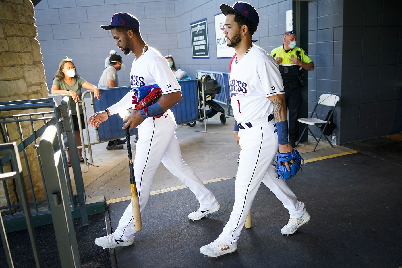Round Rock Express outfielder Leody Taveras (left) and infielder Anderson Tejeda take the field to warm up at Dell Diamond for the season opener against the Oklahoma City Dodgers on Thursday, May 6, 2021, in Round Rock, Texas. It was the first gamer for the Express in 601 days due to the COVID-19 pandemic.