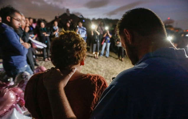 Nicole and Scott Snyder bow their heads in prayer at a vigil for Sherin Mathews in Richardson. The Snyders are founders of the Finding Sherin Mathews Facebook page and helped organize the event.