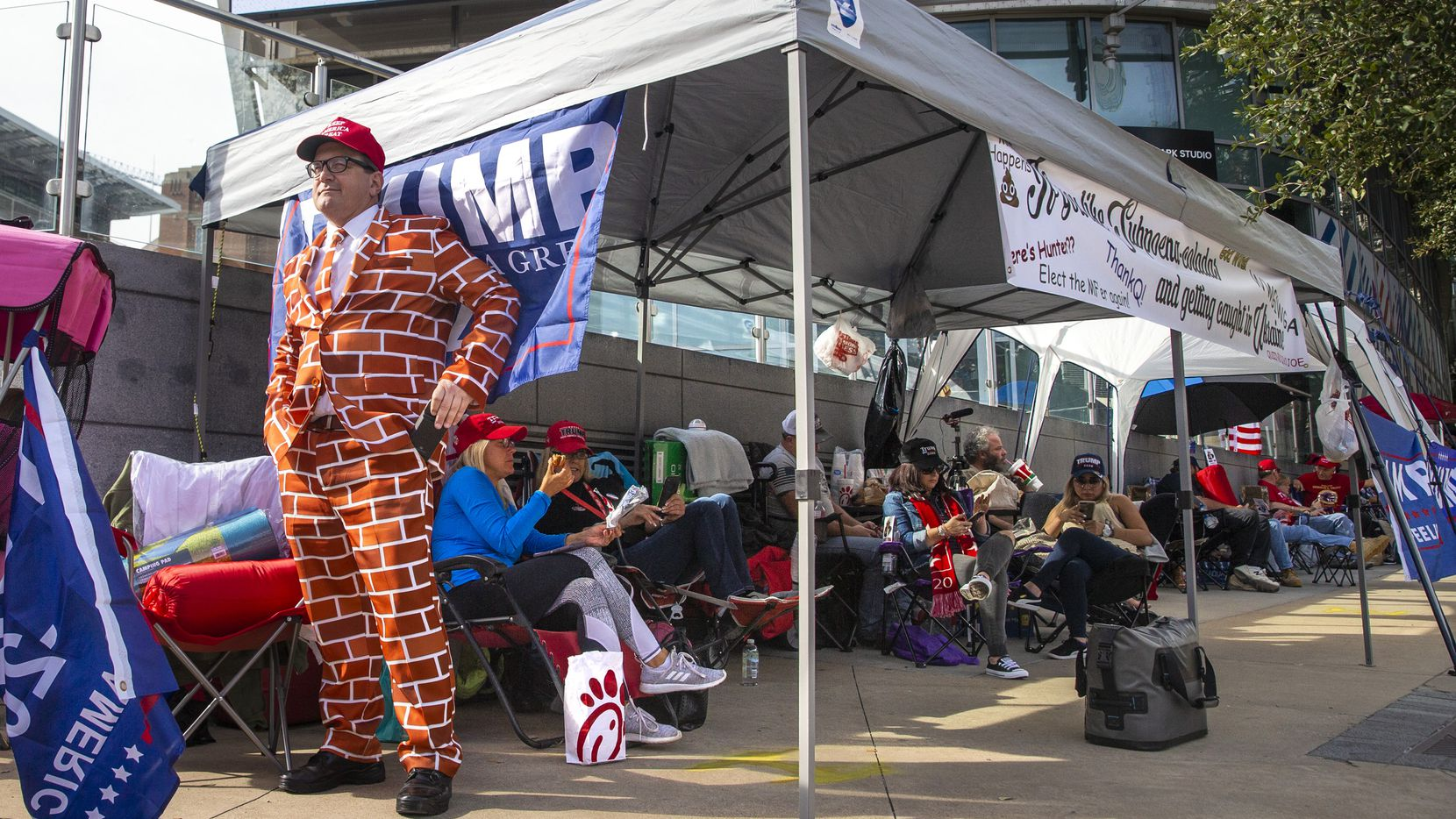 Blake Marnell wears a brick suit while camping out in line in front of American Airlines Center in Dallas on Wednesday, Oct. 16, 2019. President Donald Trump will host a rally at the center on Thursday evening.