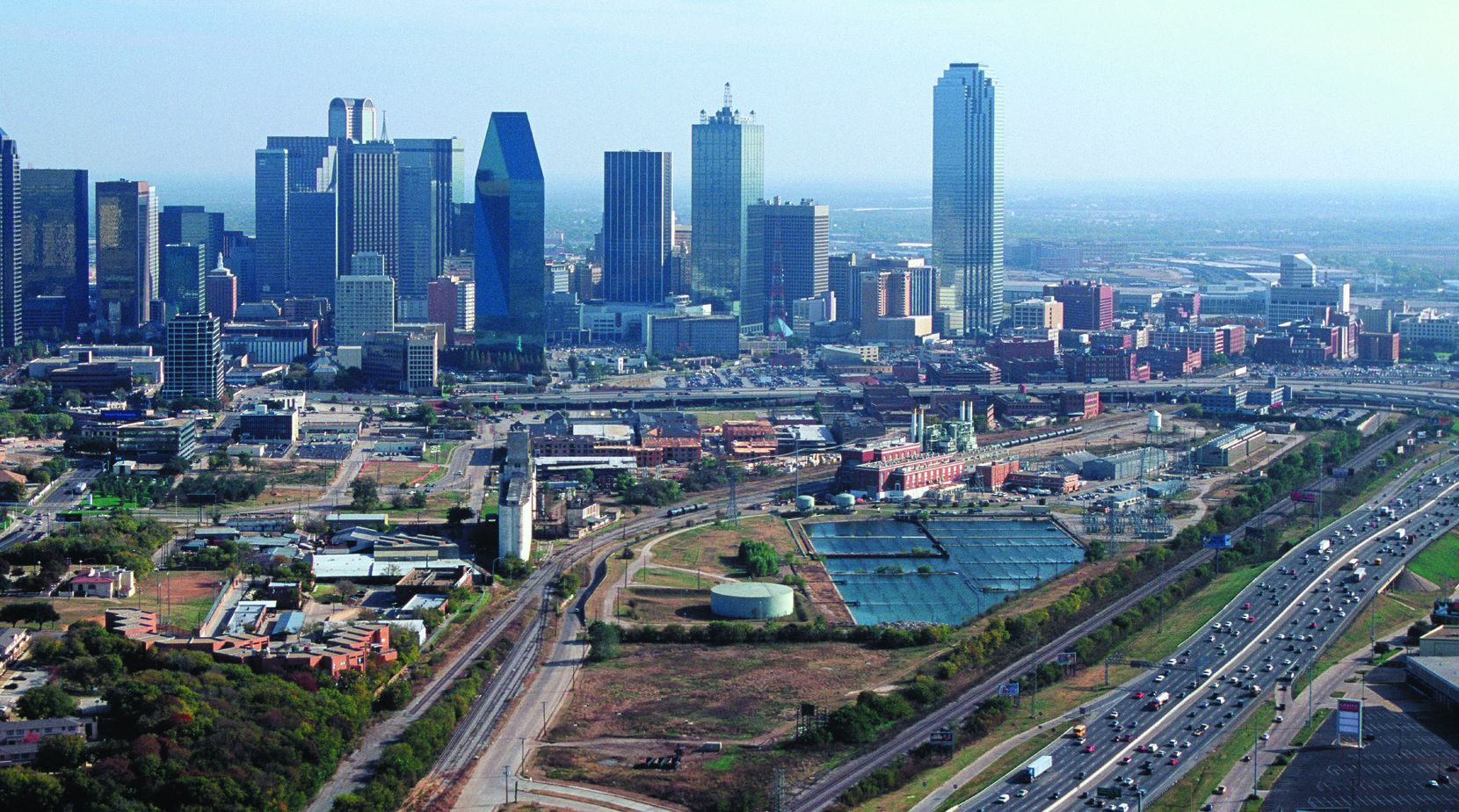 Twenty years ago Victory Park was an old rail yard, power plant and grain elevators north of downtown Dallas.