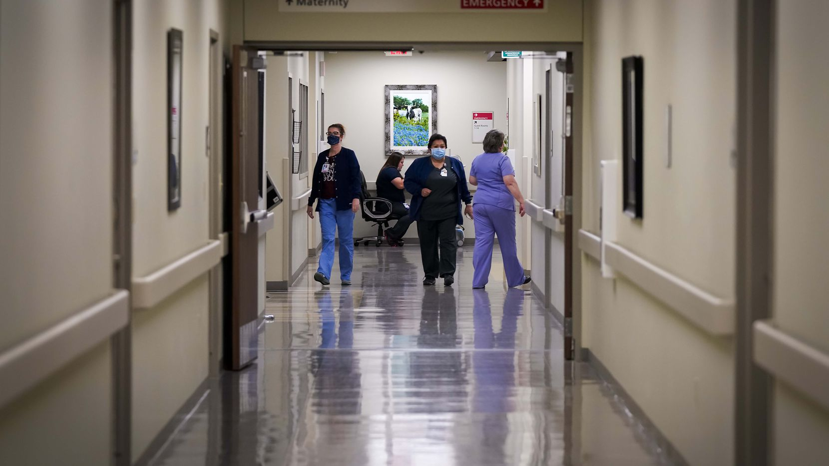 Staff at Faith Community Hospital move between rooms at the hospital on Thursday, May 14, 2020, in Jacksboro, Texas. (Smiley N. Pool/The Dallas Morning News)
