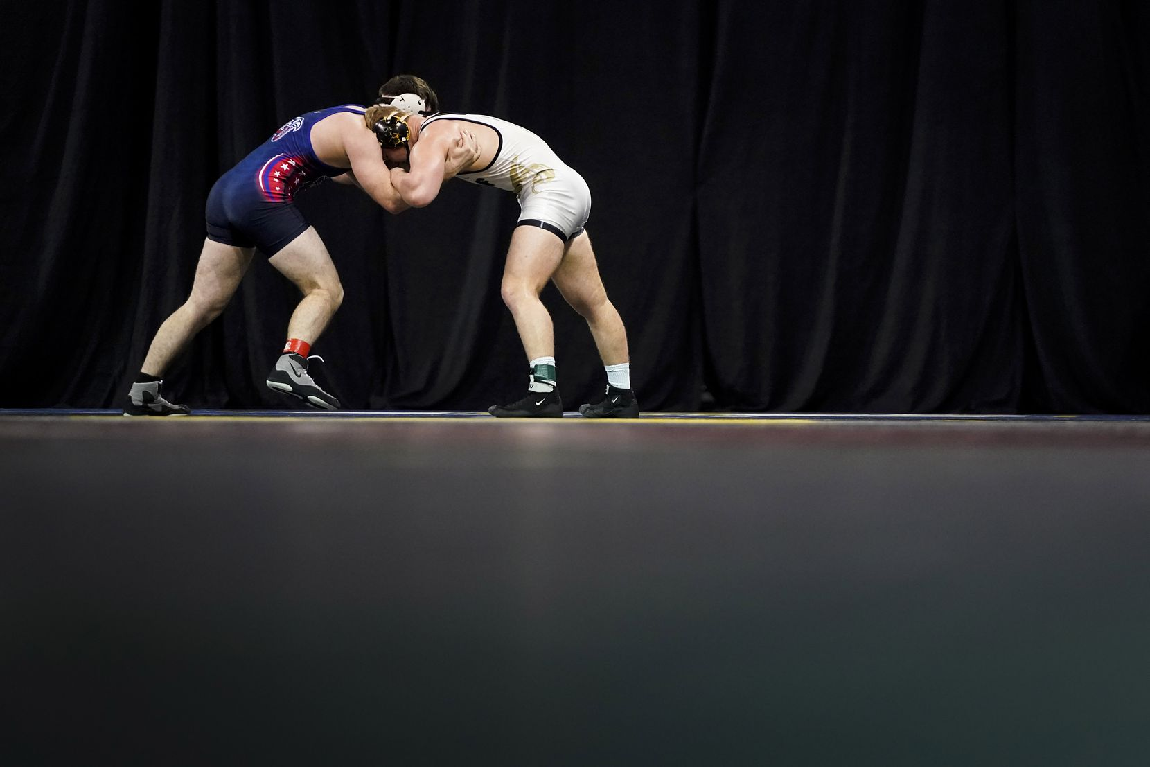Jarrod Smiley of the University Of Central Florida (facing) wrestles Ethan Martin of Liberty University in a 184 lbs semifinal during the NCWA national championships at the Allen Events Center on Friday, March 13, 2020, in Allen, Texas.