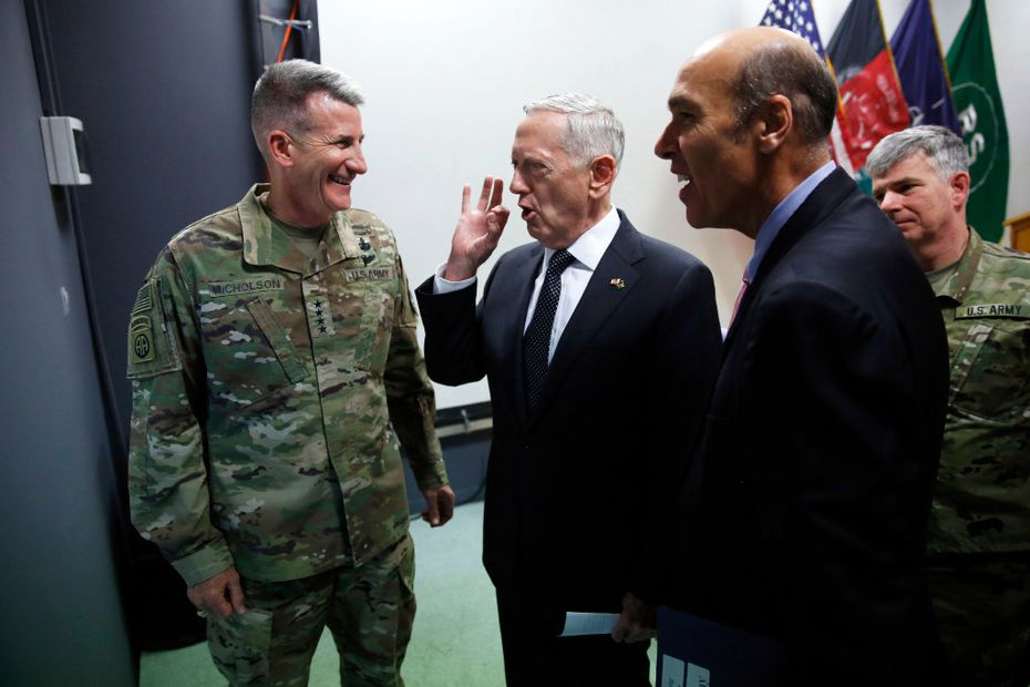 U.S. Defense Secretary James Mattis (center) chats with U.S. Army Gen. John Nicholson (left), commander of U.S. Forces Afghanistan, after a news conference at Resolute Support headquarters in Kabul last month. Mattis arrived unannounced in Afghanistan to assess America's longest war as the Trump administration weighs sending more U.S. troops.