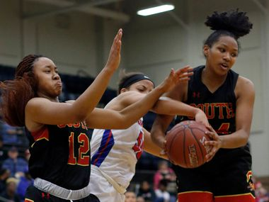 Duncanville post Zaria Rufus (50), center, battles with South Grand Prairie forward Camryn Hill (12) and guard Vasana Kearney (24) for ball possession during second half action. The two teams  played their Class 6A bi-district girls basketball playoff game at Mansfield Timberview High School in Arlington on February 12, 2019. (Steve Hamm/ Special Contributor)