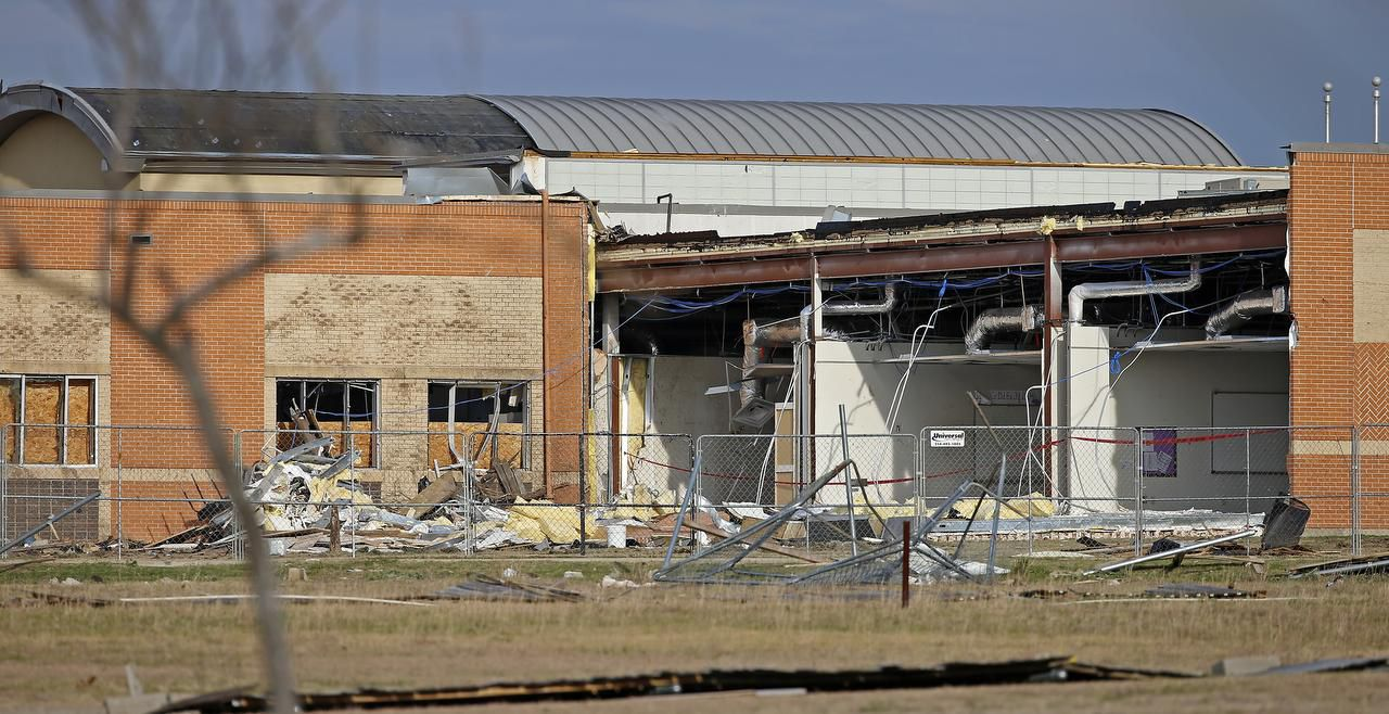 Storm damages of Donald T. Shields Elementary School are seen from Lake Ridge Drive in Red Oak.