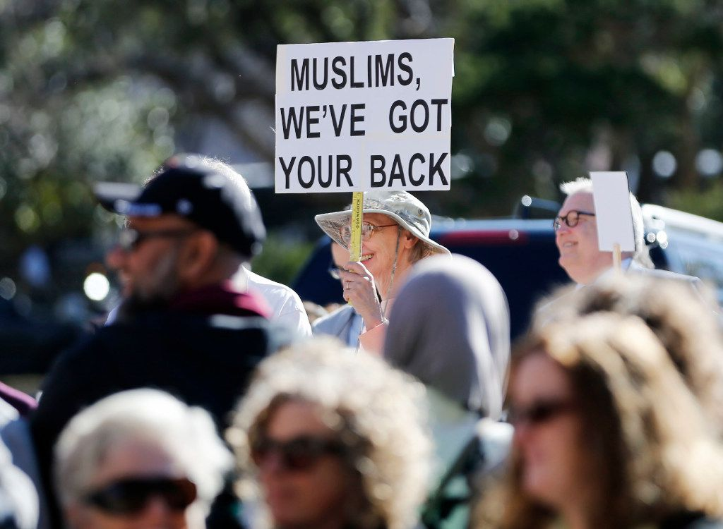 A woman holds up a sign during a Texas Muslim Capitol Day rally in Austin on Tuesday, January 31, 2017. (Vernon Bryant/The Dallas Morning News)