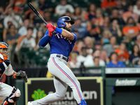 Texas Rangers' Joey Gallo, right, hits a RBI-double as Houston Astros catcher Martin Maldonado watches during the fourth inning of a baseball game Tuesday, June 15, 2021, in Houston.