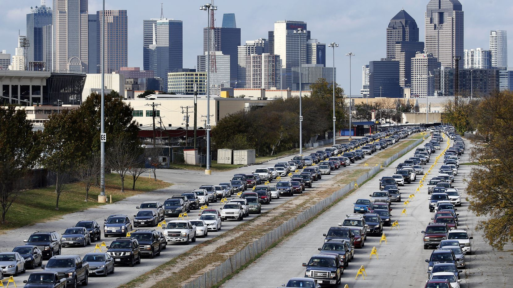 Vehicles surrounded Fair Park as they awaited entry to the North Texas Food Bank's mega-distribution on Saturday.