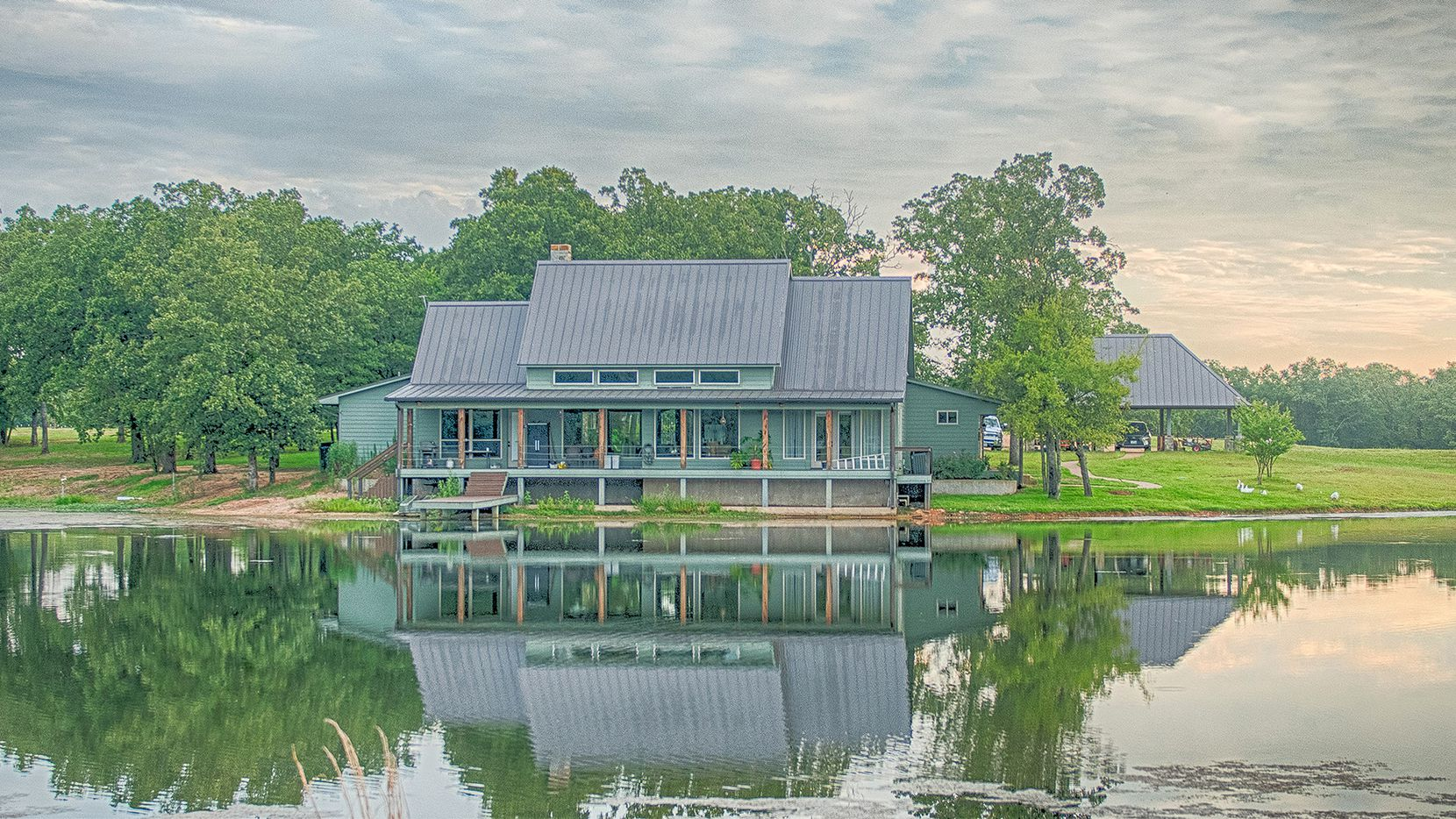 Steve Grant Real Estate is marketing this 156.11-acre property with a main house and lodge in East Texas.