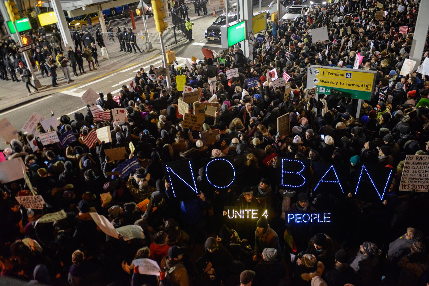 Protestors rally  during a demonstration against the Muslim immigration ban at John F. Kennedy International Airport on January 28, 2017 in New York City.