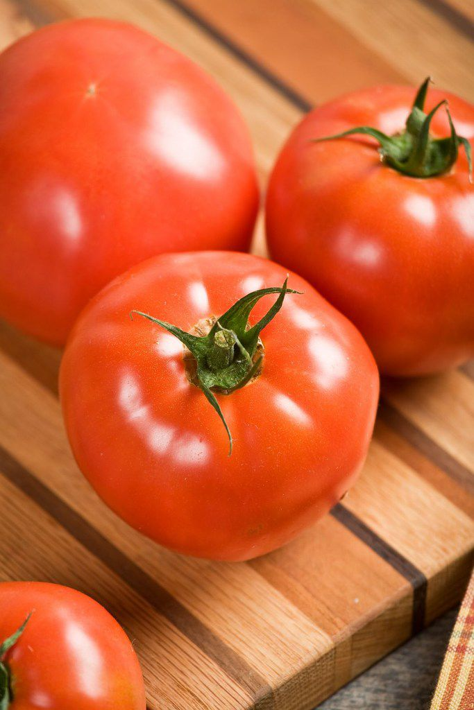 The 'Celebrity' tomato is a mid-early determinate variety that starts producing in about 70 days from transplant.