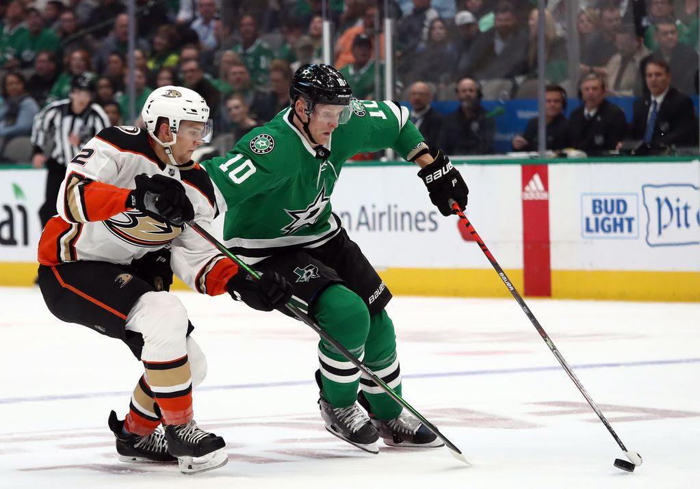 DALLAS, TEXAS - OCTOBER 24:  Corey Perry #10 of the Dallas Stars skates the puck against Brendan Guhle #2 of the Anaheim Ducks in the first period at American Airlines Center on October 24, 2019 in Dallas, Texas. (Photo by Ronald Martinez/Getty Images)
