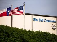 In thus April 23, 2015 file photo, flags flutter in the breeze outside of the Blue Bell Creameries in Brenham, Texas.  (Smiley N. Pool/The Dallas Morning News)