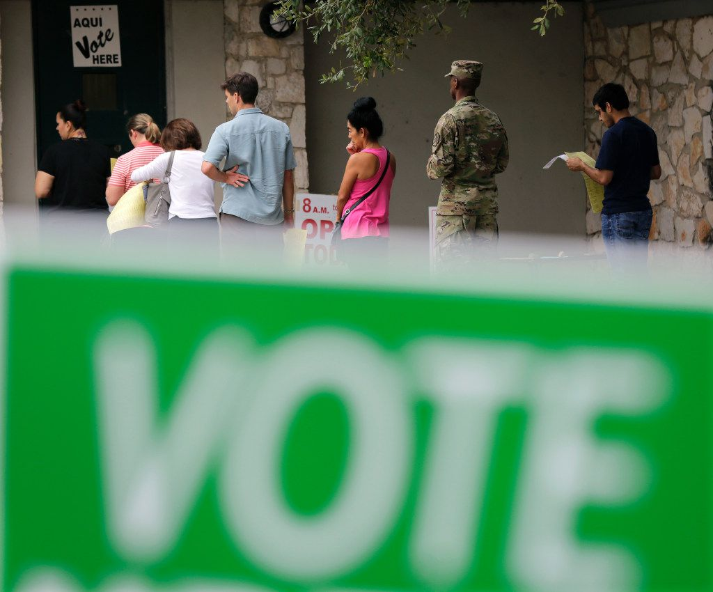 Voters wait in line to cast ballots at an early polling site, Friday, Nov. 4, 2016, in San Antonio. Friday is the last day of early voting in Texas. The polls will reopen on Election Day, Tuesday, Nov. 8, 2016. (AP Photo/Eric Gay)