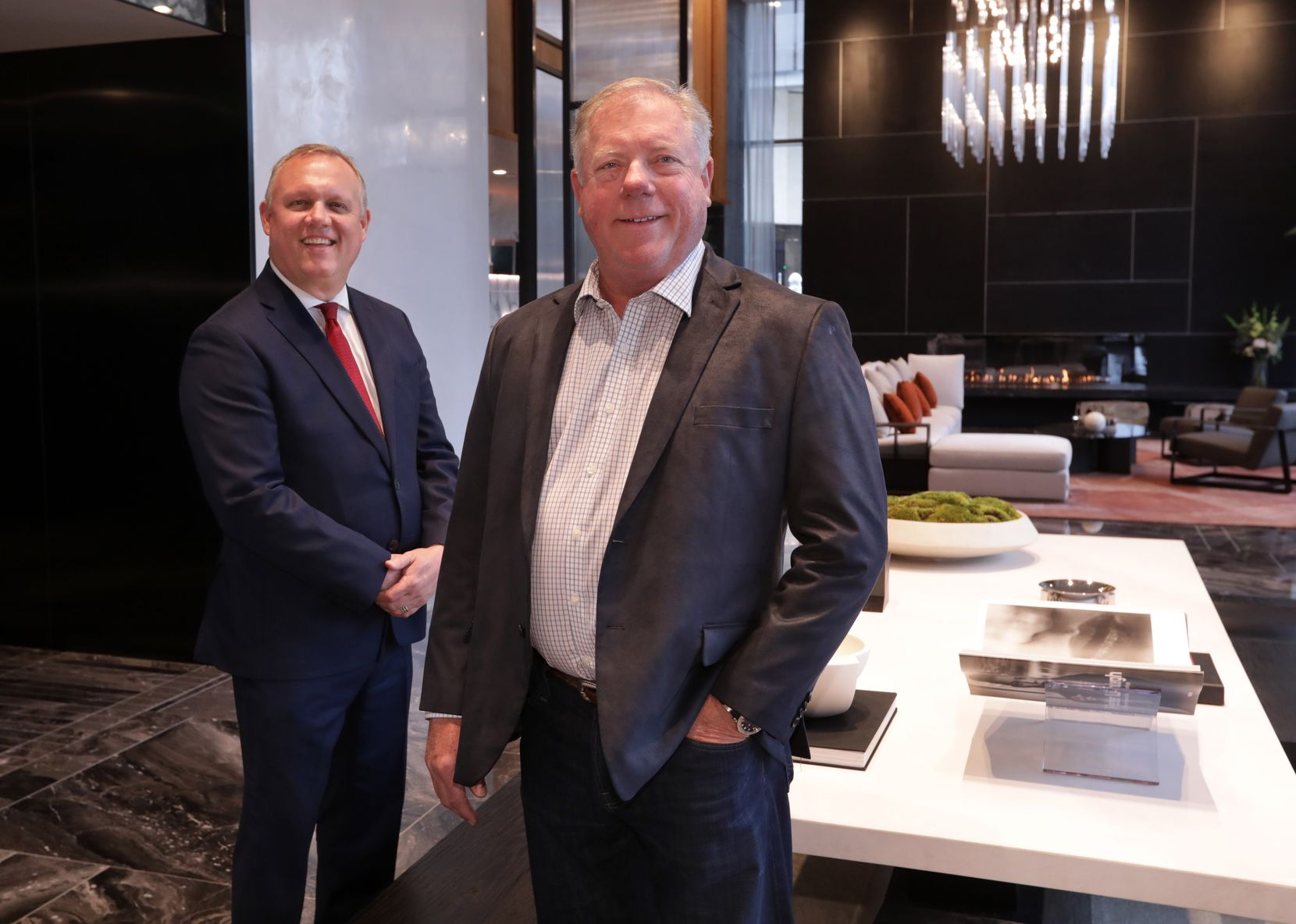 General manager Duane Bates, left, and developer Jim Duggan in the lobby of the  Windrose Tower in Plano. (Jason Janik/Special Contributor)
