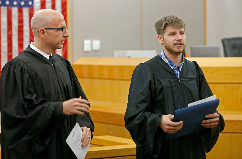 Charles Troutman (right) spoke next to Judge Brandon Birmingham during a graduation ceremony of the Achieve Inspire Motivate program at the 292nd Judicial District Court in Dallas on Monday, Troutman was charged with Impersonating a public servant in 2015 and his case has been dismissed after he completed the program.